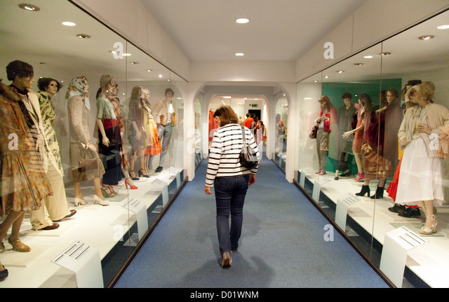 A woman looking at costumes in the fashion Museum  Bath Somerset UK   Stock  ImageBath Fashion Museum Stock Photos   Bath Fashion Museum Stock  . Bath Fashion Museum Gift Shop. Home Design Ideas