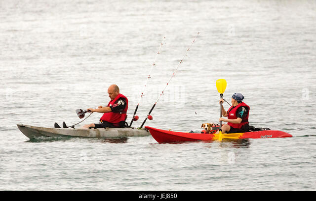 Woman Kayaking By Harbor Stock Photos Amp Woman Kayaking By