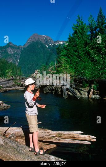 Boy fishing british columbia canada stock photos boy for Fishing vancouver island