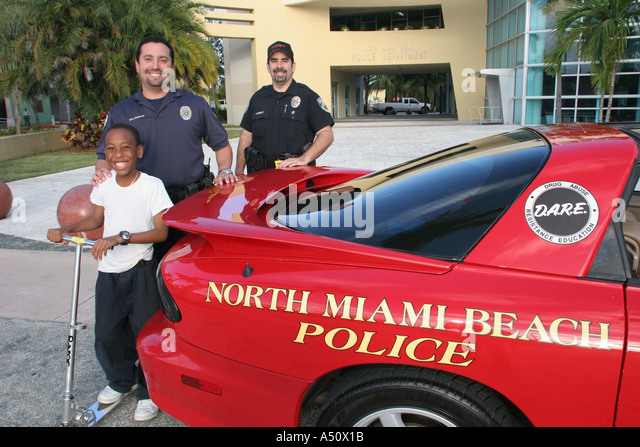 North Miami Beach Florida Police Department DARE Anti Drug Promotion Red  Sports Car Black Male Boy
