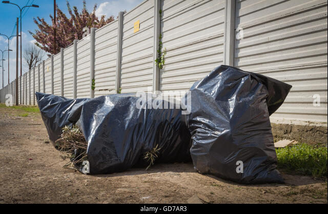 image of black garbage bag on the street. - Stock Image & Black Garbage Bag Stock Photos u0026 Black Garbage Bag Stock Images ...