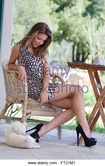 Amazing leggy women with a dog for companionship stock image