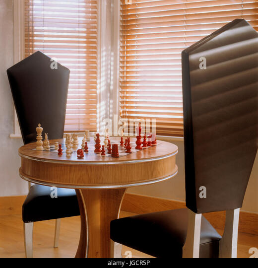 Chess Table With Black Chairs   Stock Image