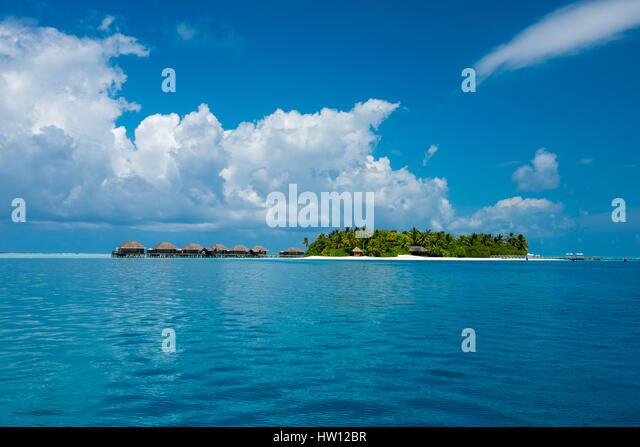 Water villas maldives stock photos water villas maldives for Hilton hotels in maldives