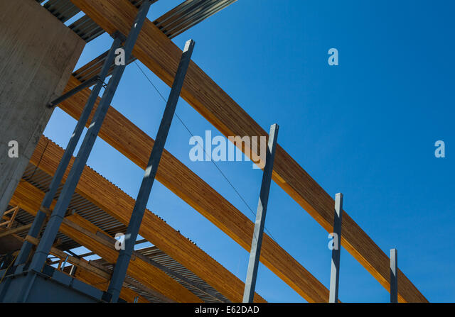 Beautiful Array Of Large Laminated Wooden Beams Used As A Roof Support In An Open Plan