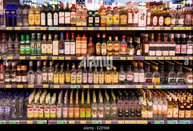 shelf-with-food-in-a-supermarket-spirits-liquors-alcohol-e2jy6m.jpg