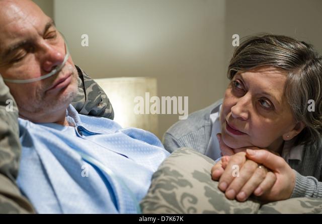 Elderly Couple Holding Hands Sad Stock Photos & Elderly