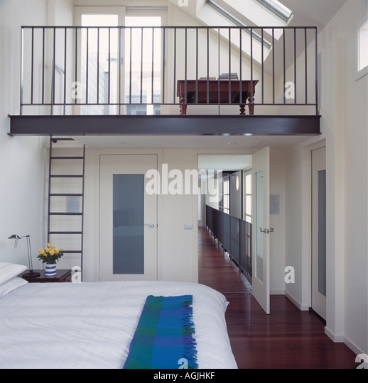 Bedroom with overlooking mezzanine - Stock Image