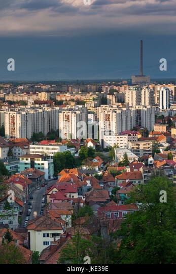 Romania, Transylvania, Brasov, new city and CET Brasov thermal energy plant, late afternoon - Stock Image