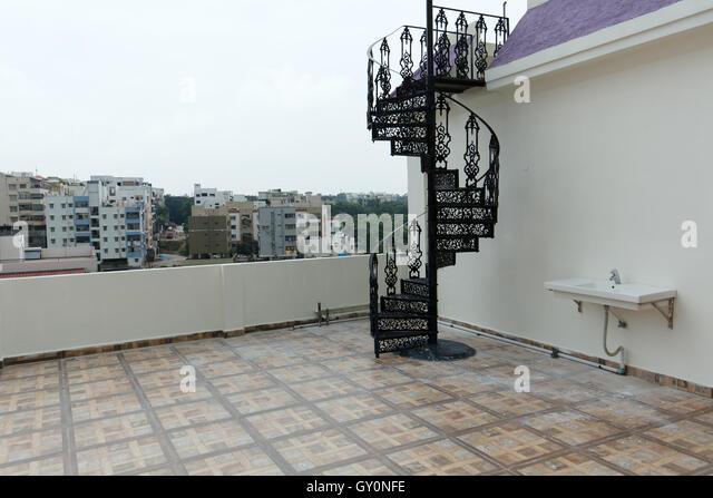 Forged Iron Spiral Staircase On Terrace   Stock Image