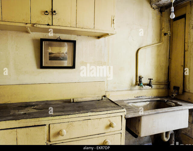 An Old Fashioned Kitchen Sink And Cupboards.   Stock Image