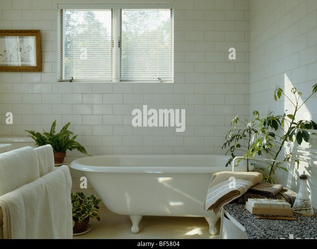 Roll  Top Bath Below Window In White Country Bathroom With White Tiled  Walls   Stock Part 65
