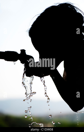 Young Poor Lower Caste Indian Girl Drinking From A Water Tap Andhra Pradesh India