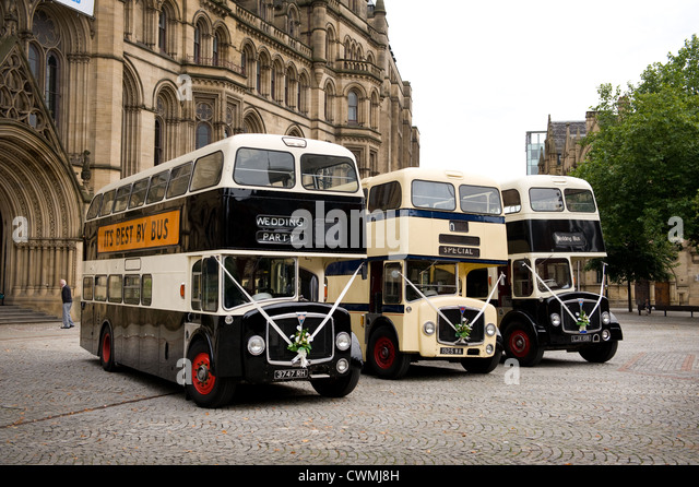 Three Vintage Wedding Buses Parked Outside Manchester Town Hall UK