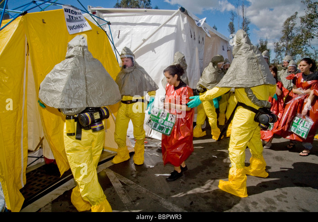 personnel direct volunteer victims in disposable emergency outfits to a spray decontamination tent Mission Viejo - & Decontamination Shower Stock Photos u0026 Decontamination Shower Stock ...
