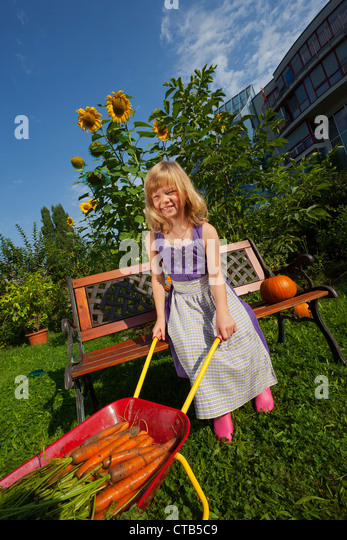 urban farming children stock photos urban farming children stock images alamy. Black Bedroom Furniture Sets. Home Design Ideas