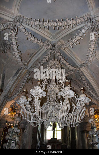 Bone chandelier stock photos bone chandelier stock images alamy chandelier made entirely of human bones and skulls in the sedlec ossuary near the town of aloadofball Image collections