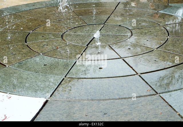 Bon Floor Fountain Splashing Water Jets Upwards Into The Air   Stock Image