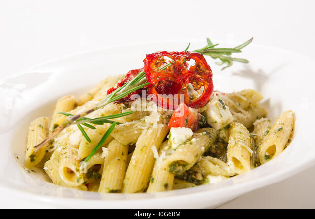 Penne Pasta with cheese feta, spinach, pesto and sun-dried tomatoes ...
