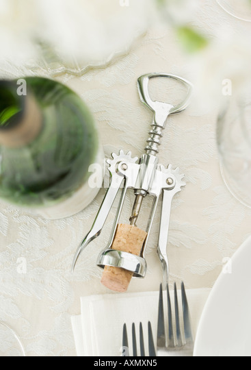 Table Setting With Wine And Corkscrew   Stock Image