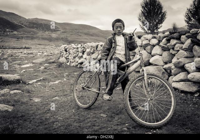 Poor Boy Bicycle Portrait Stock Photos Poor Boy Bicycle Portrait