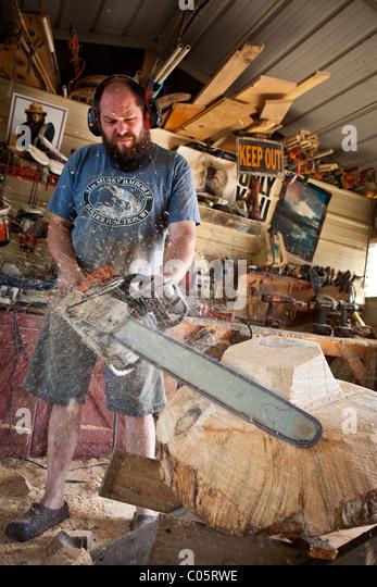 Chainsaw artist stock photos