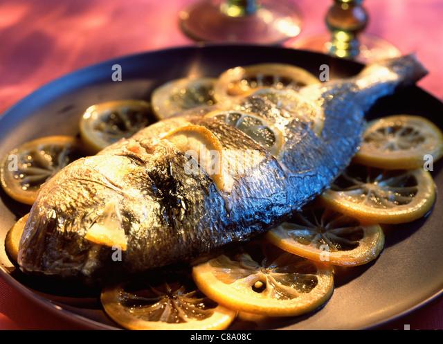 Caramelized sea bream with lemon - Stock Image