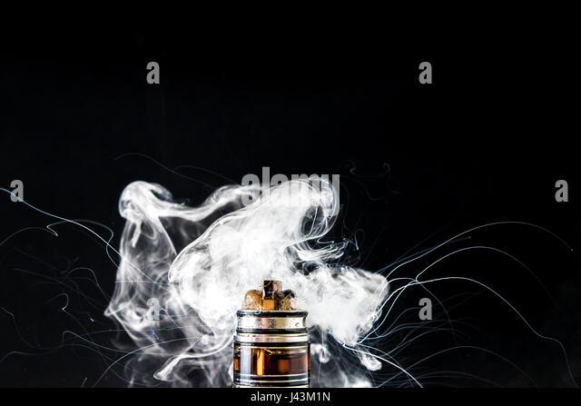 Dissassembled electronic Cigarette vape cloud - Stock Image