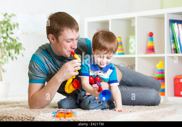 Boy Toys For Dads : Boy playing saxophone stock photos