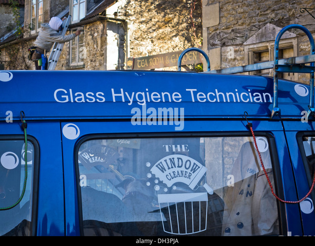 window cleaners van and at work on cottage windows stock image - Window Cleaner Job Description