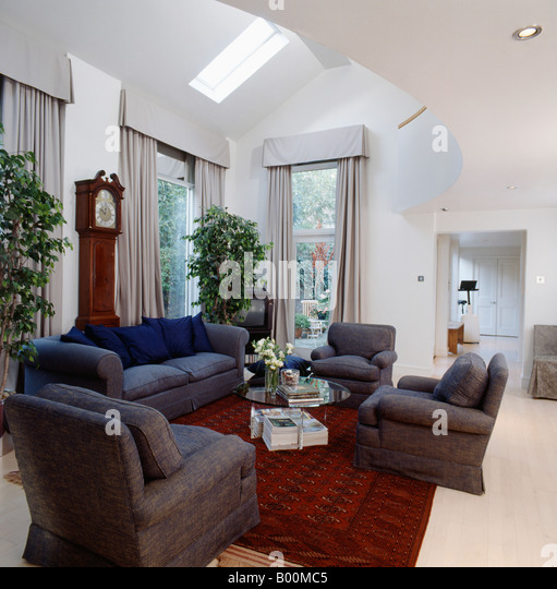 Grey Armchairs And Red Oriental Rug In Eighties Living Room Extension With  Tall Houseplants And Longcase Part 68