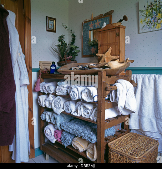 Rolled towels stored on old baker  39 s rack in cottage bathroom   Stock Image. Furniture Blue Traditional Cottage Stock Photos  amp  Furniture Blue
