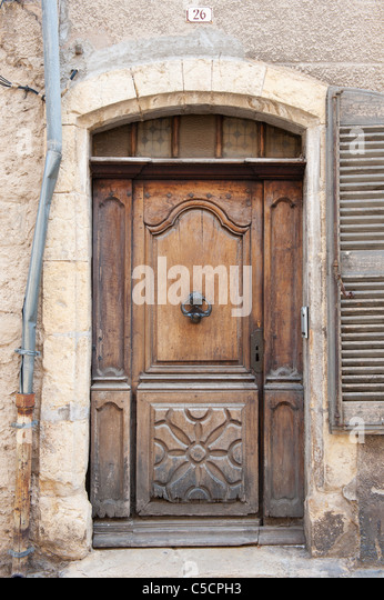 old closed wooden french door with knocker stock image
