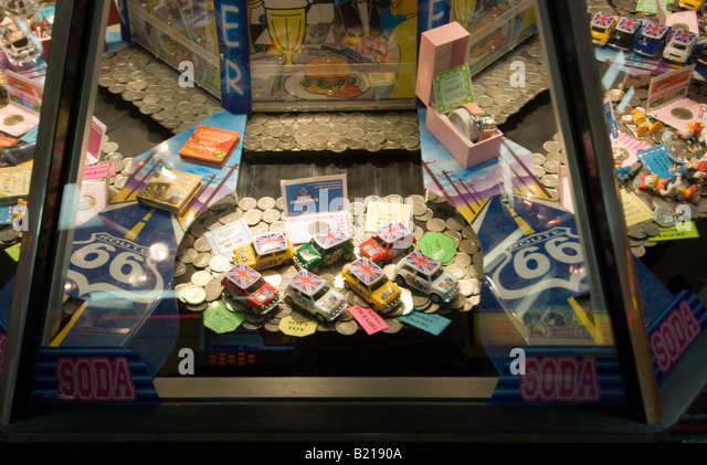 Image result for penny pushing machine