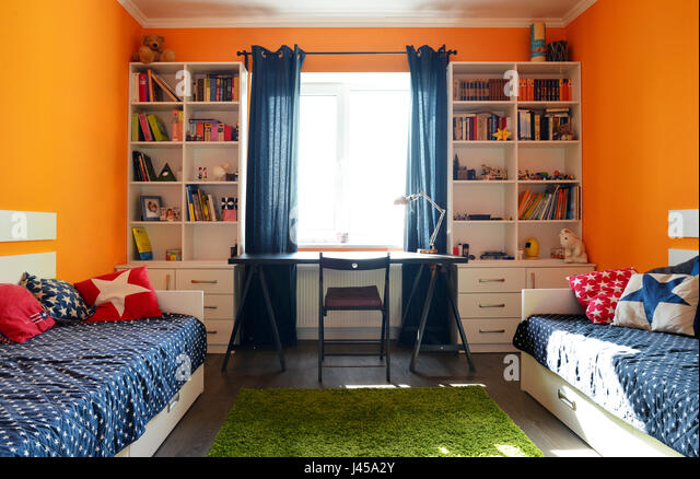 Kids bedroom in orange and blue colors with two beds and bookcases   Stock  Image. Bedroom With Bookcases Stock Photos   Bedroom With Bookcases Stock