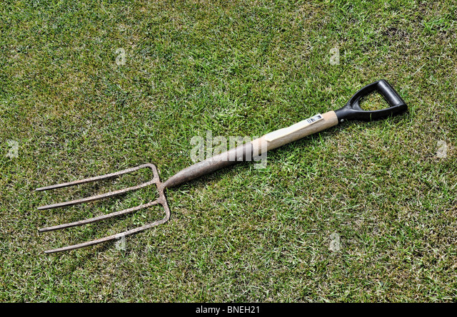Old gardening fork stock photos old gardening fork stock for Gardening tools for 6 year old
