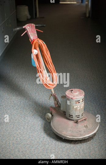floor polisher for wooden and vinyl floors waiting on a carpeted corridor stock image