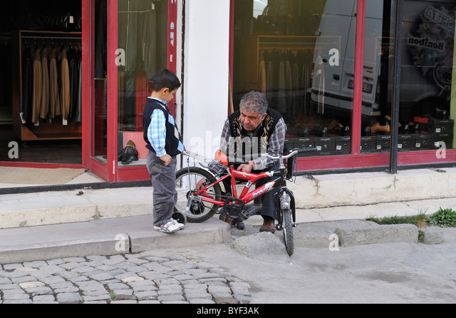 grandpa-putting-training-wheels-on-littl