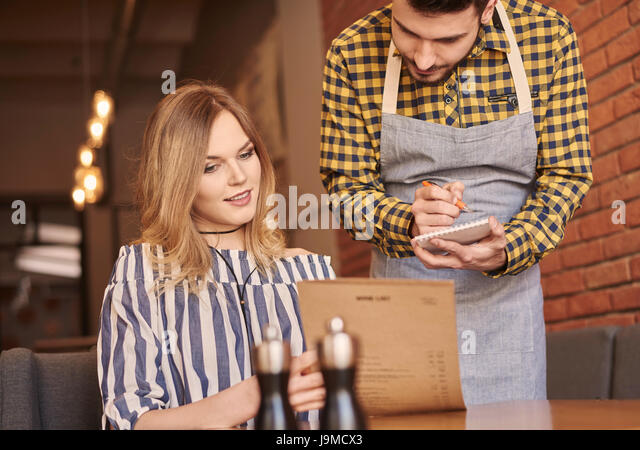 Young woman placing an order - Stock Image