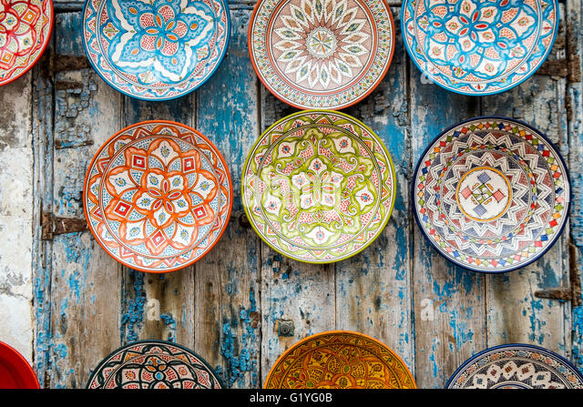 souvenir decorative plates on a wall in essaouira morocco stock image - Decorative Plates For Wall