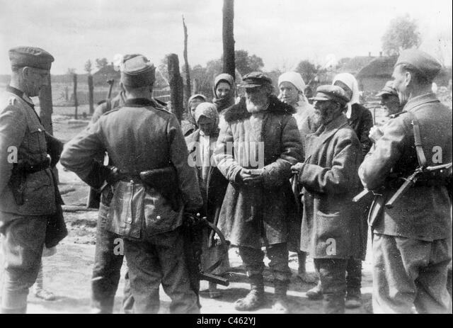 german police interrogate villagers on the eastern front 1943 stock image