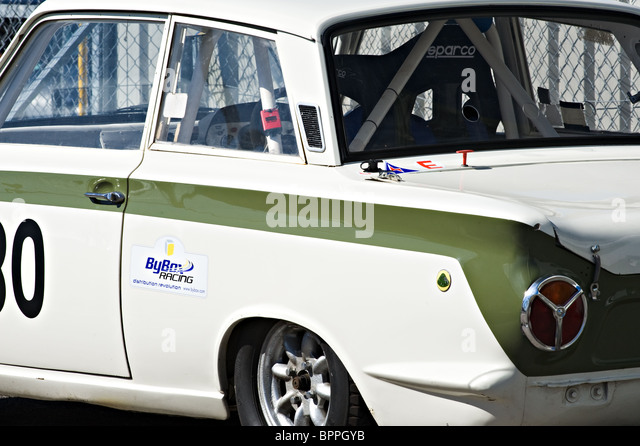 ford lotus cortina historic saloon race car in paddock at oulton park motor racing circuit cheshire