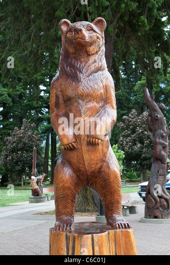 Bear wood carving stock photos