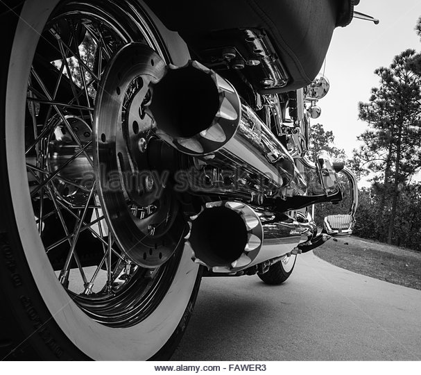 motorcycle dual chrome exhaust pipes with whitewall tires stock image