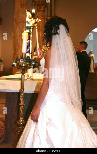 Bride lighting a candle during church wedding ceremony - Stock Image & Candle Lighting Ceremony Stock Photos u0026 Candle Lighting Ceremony ... azcodes.com