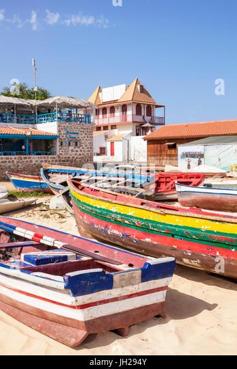 Colourful traditional local fishing boats on the beach at Santa Maria, Praia da Santa Maria, Sal Island, Cape Verde, - Stock Image