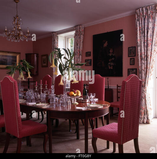 Pink Upholstered Chairs At Table Set For Lunch In Pink Nineties Dining Room  With Tall Vases