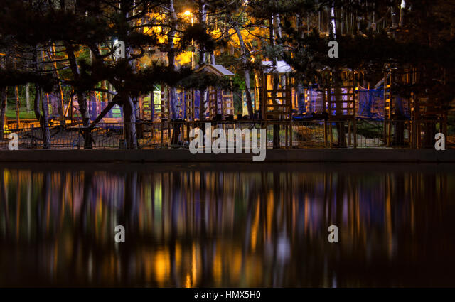 amazing dark night park view with small houses ladders roads and steps colorful lighting o