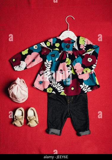 top view fashion trendy look of baby girl clothes and toy stuff, baby fashion concept - Stock Image
