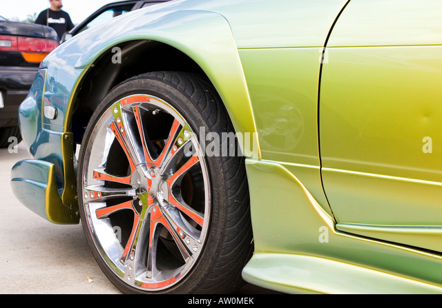 close up of chrome car front wheel and mudguard stock image